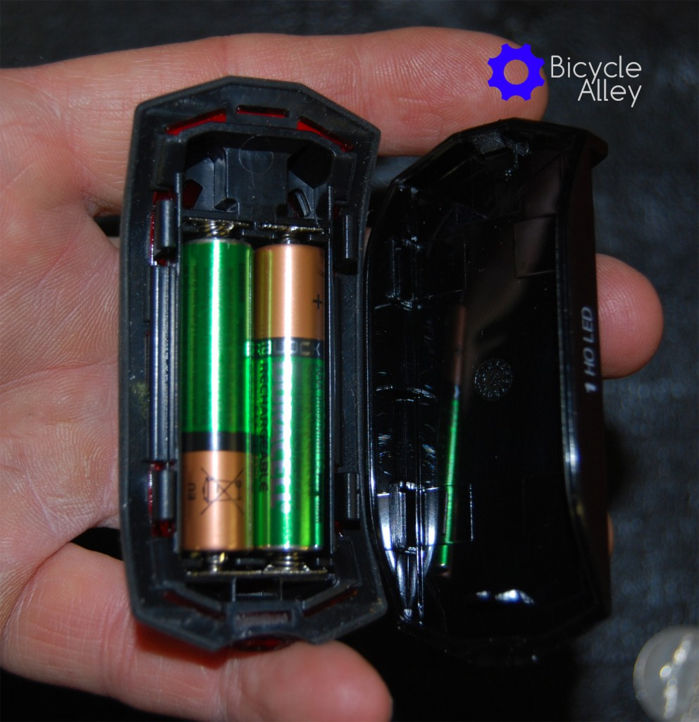 The Bell Arella 100 Tail Light battery compartment with 2 Duracell rechargeable AAA batteries.