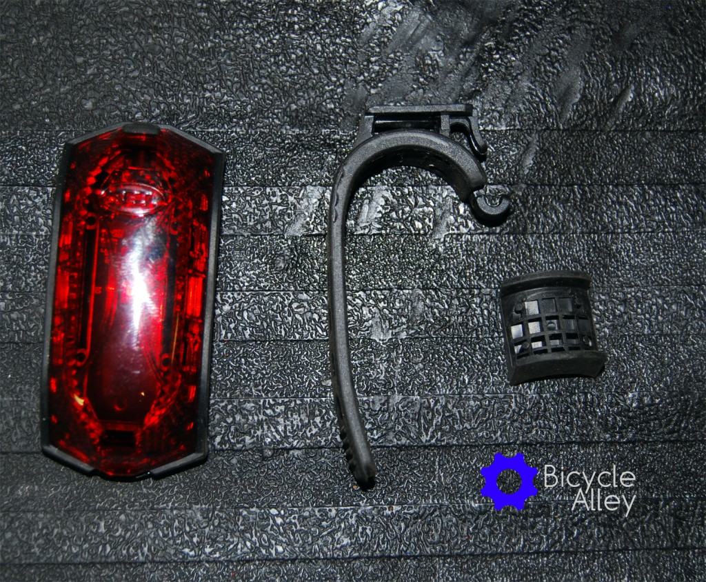 Everything included in the package for the Bell Arella 100 Tail Light. From left to right: Bell Arella 100 Tail Light, silicon mounting strap and shim.