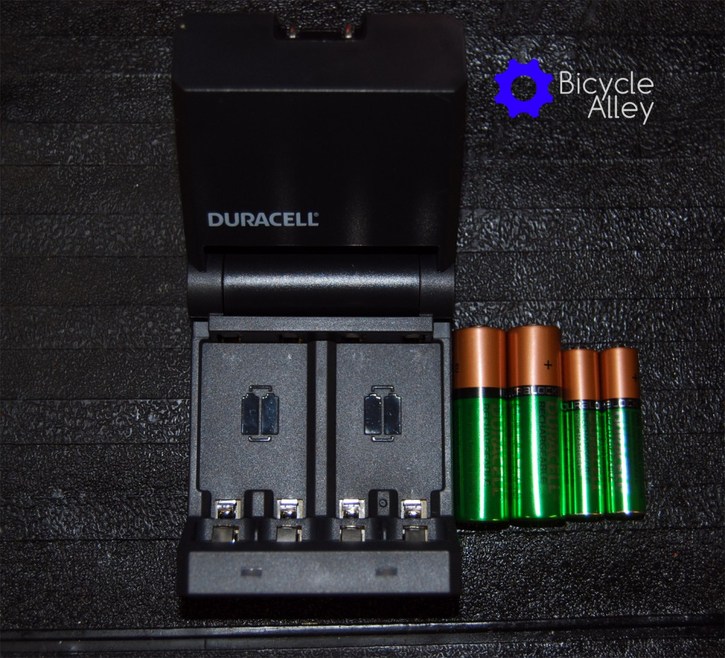 The Duracell Ion Speed 400 battery charger with 2 AA and 2 AAA batteries.