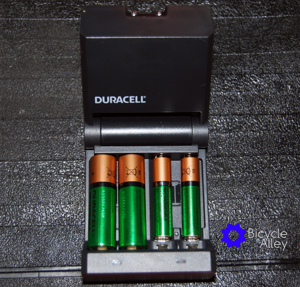 The Duracell Ion Speed 400 battery charger with 2 AA and 2 AAA batteries. You can charge up to 4 AA or 4 AAA batteries at a time or any combination of the two.