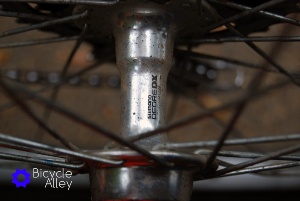 The original Shimano Deore DX rear wheel hub.